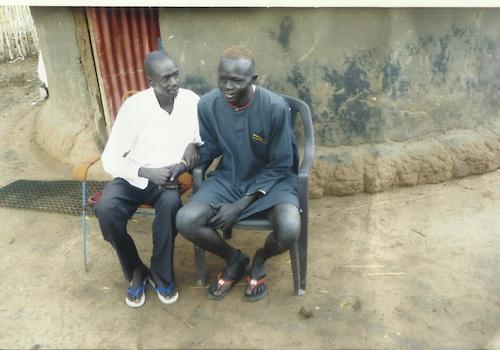 Two men sitting och chairs