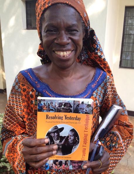 Godelieve Mukasarasi with book